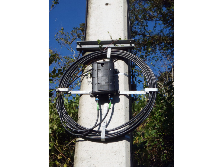 Dispositif de lovage pour câble fibre optique